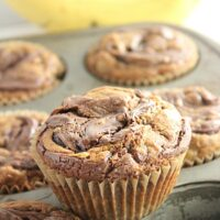 Nutella Swirled Banana Muffins- Big Green House #biggreenhouseblog #nutella #chocolatehazelnutspread #banana #muffins